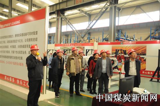 贵州盘江股份公司组织人事部部长邓骅带领机关部室人员到盘江矿机公司参观党建工作